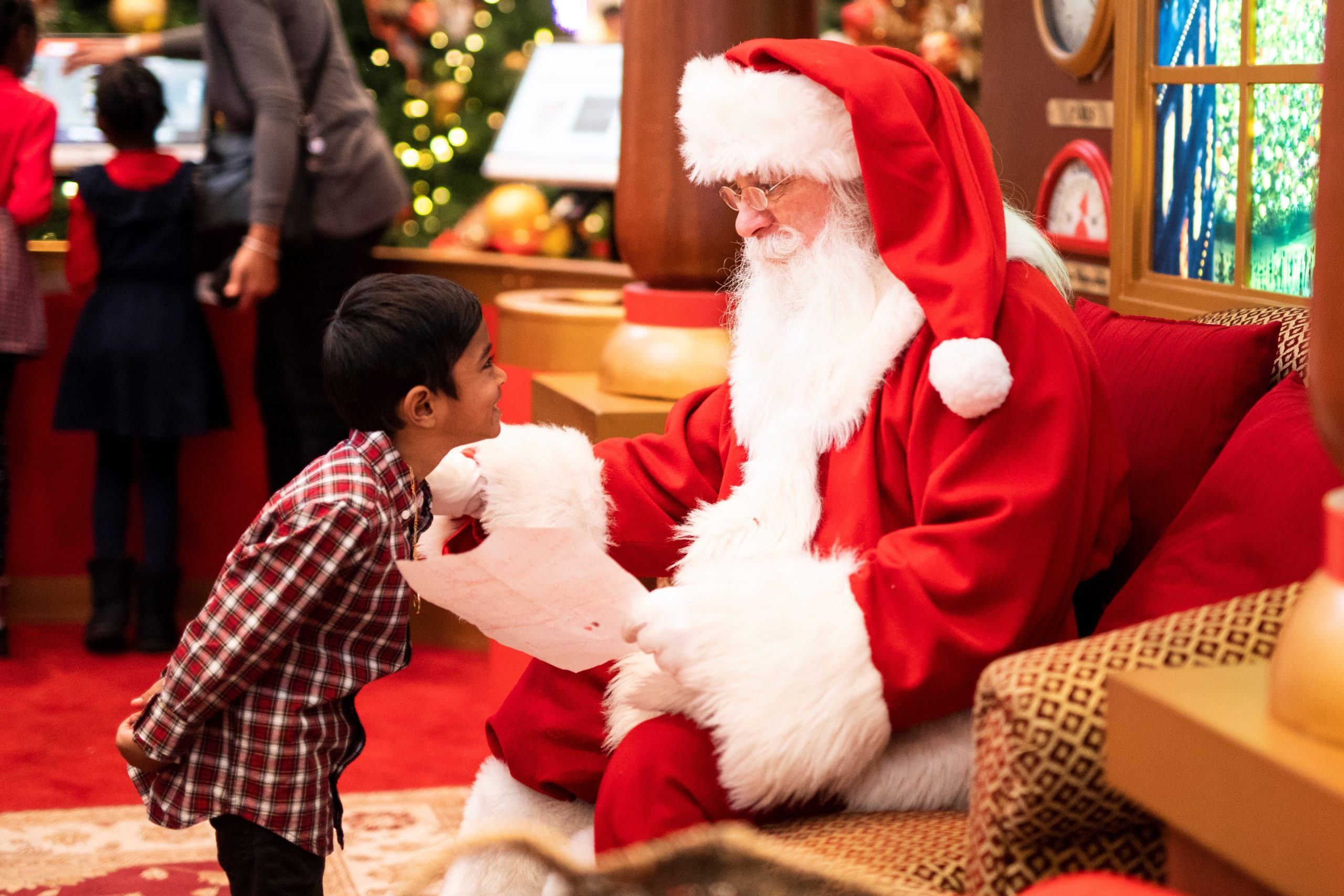 boy with santa tips for parents on getting great santa pictures