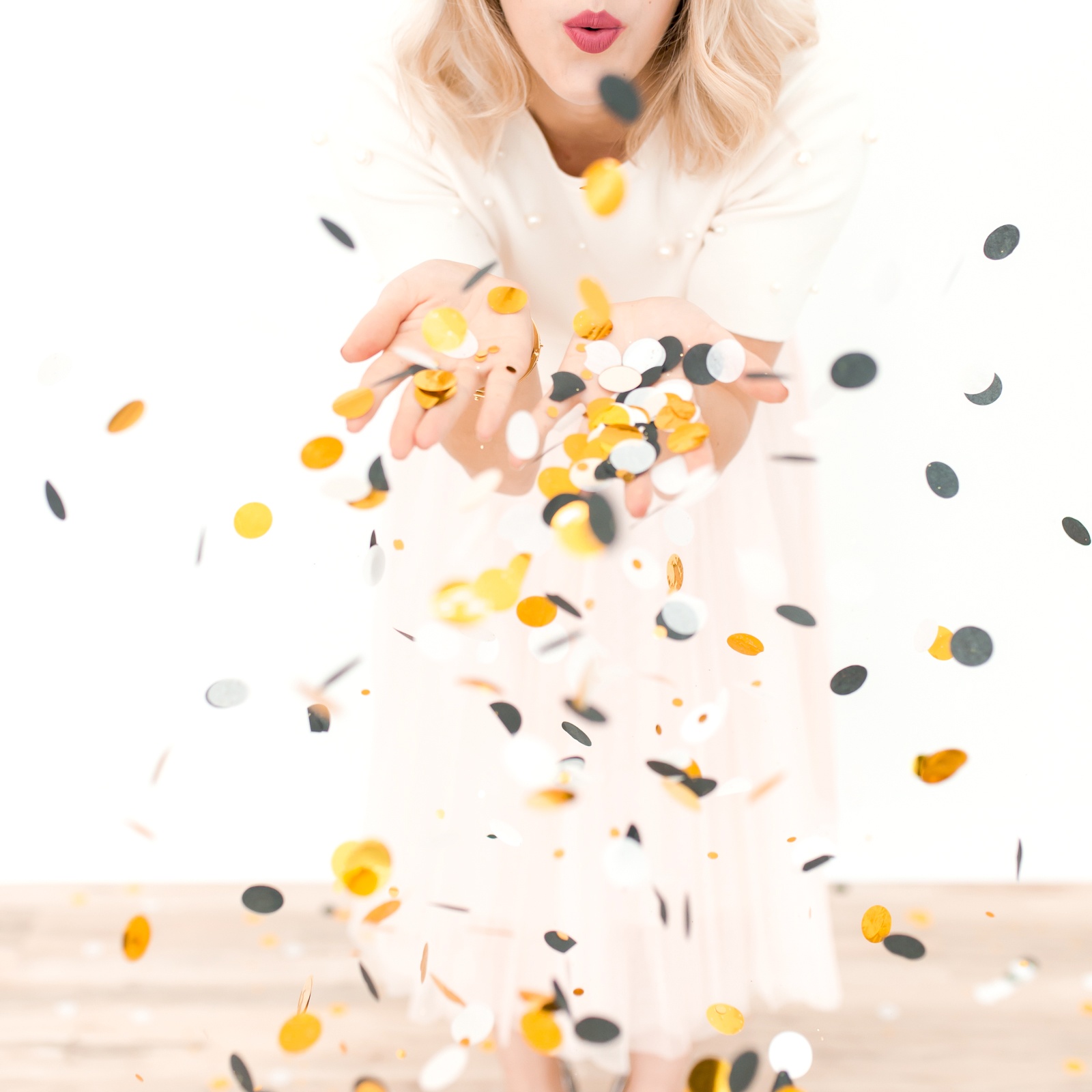 girl blowing confetti from her palms   3 alternatives to new year's resolutions