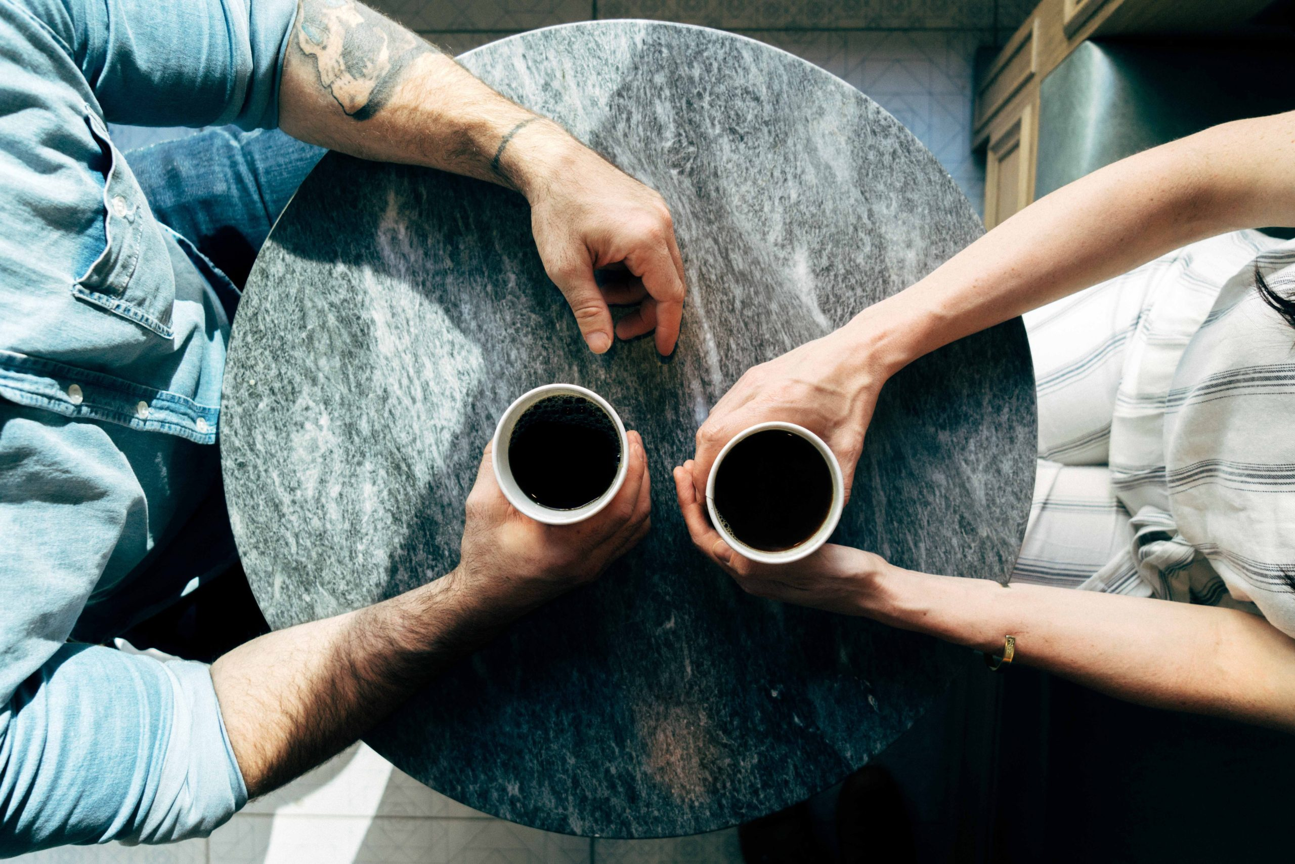 a couple sitting at a table together | Romance in Marriage