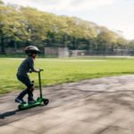 kid on green scooter | is your child too busy