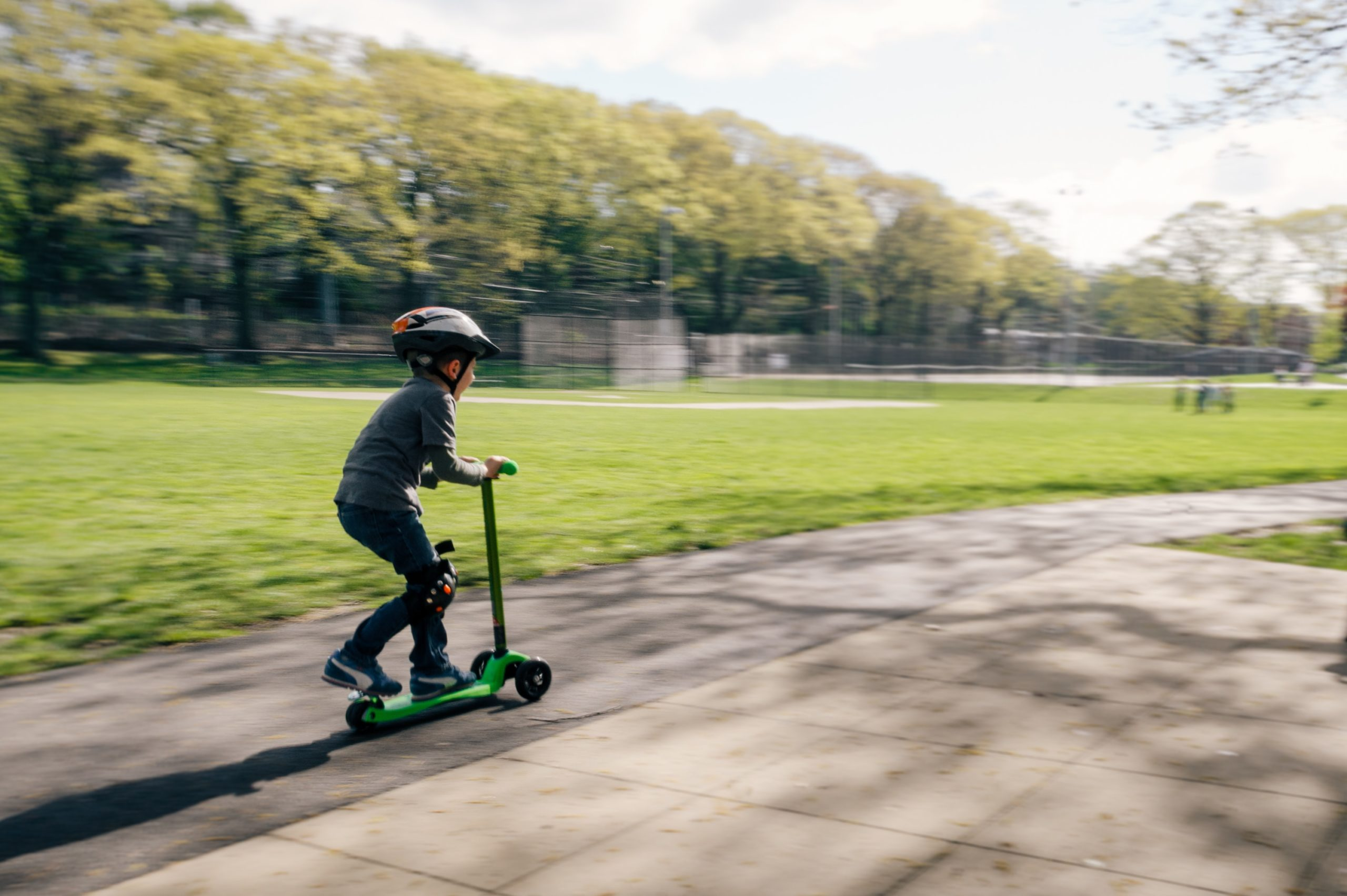 kid on green scooter   is your child too busy