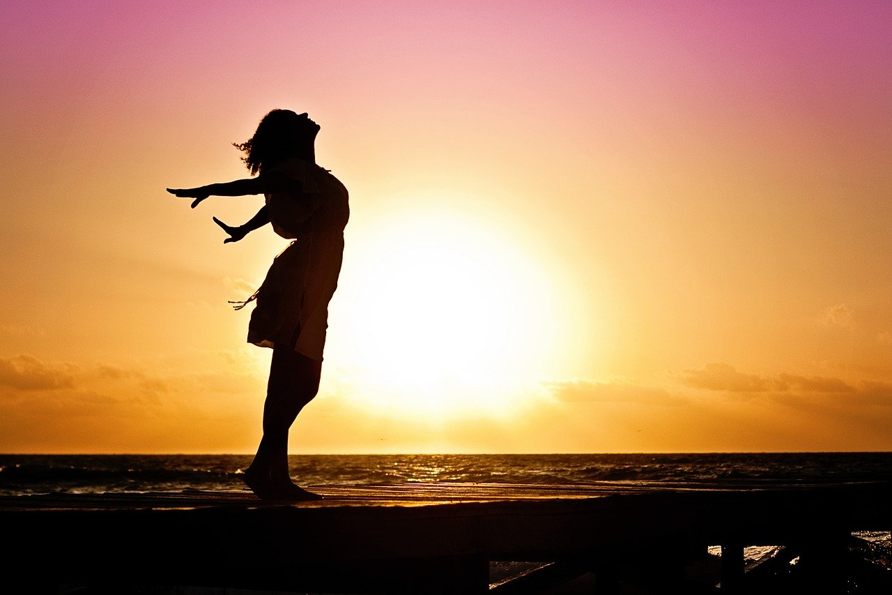 shadow of woman being free at sunset   one moms mission to grow