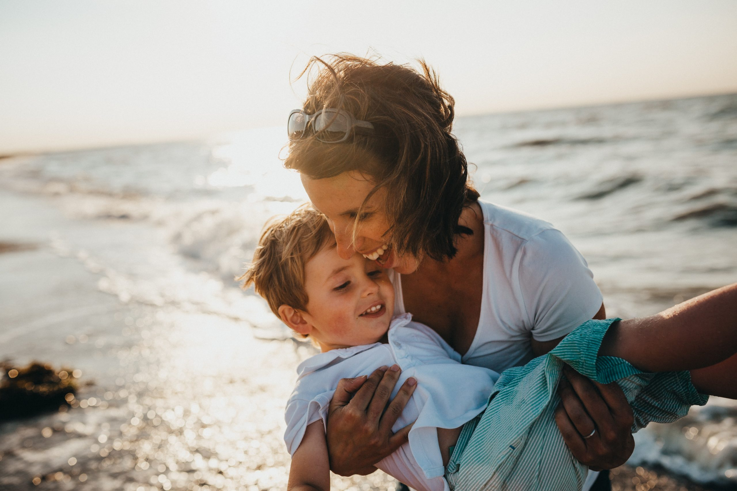 mom holding son at beach   Words of wisdom from my dad what the greatest success is