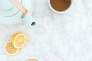 tea, honey and lemon on counter | Natural cold remedies for moms and littles