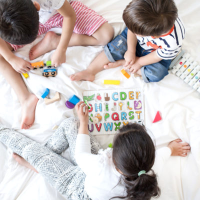 Three kids playing on bed | 101 activities for your kids to do at home