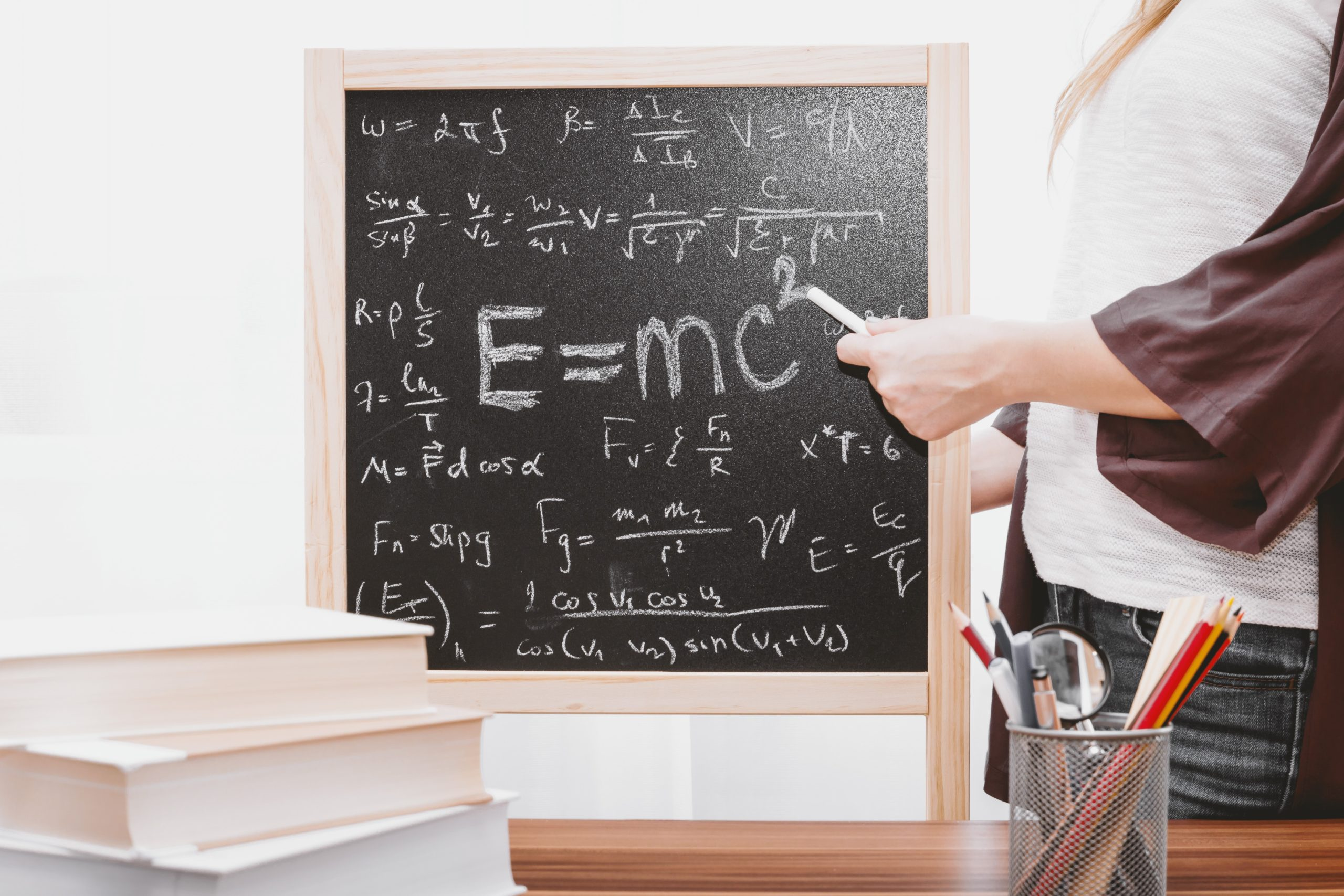 Chalkboard with E=mC2 on board | Tips On Keeping A (Semi) Normal Homeschooling Routine With The Kids At Home