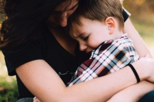 Mom hugging toddler boy The Beauty of Discomfort