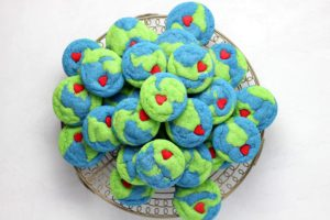 Earth-shaped cookies on a tray | 15 Ways Families Can Help Save Our Planet