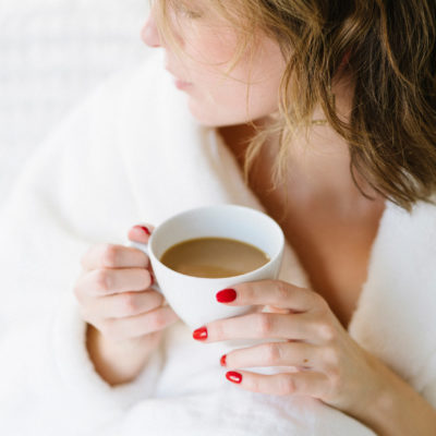 woman holding cup of coffee | ways to stay sane