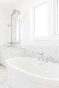 side picture of an all-white bathroom