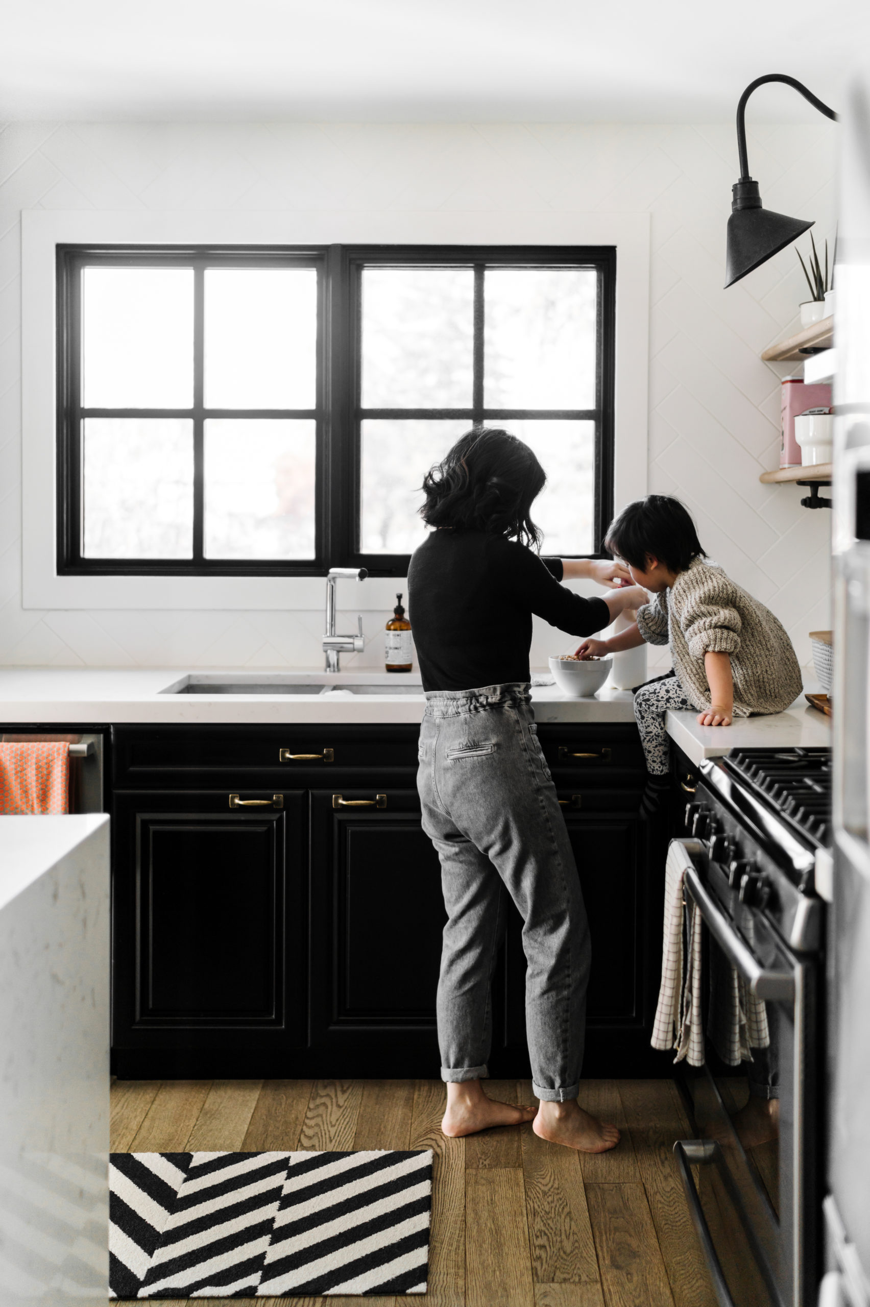 mom in kitchen with son on counter | healthy snacking during a pandemic