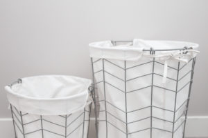 two white laundry baskets