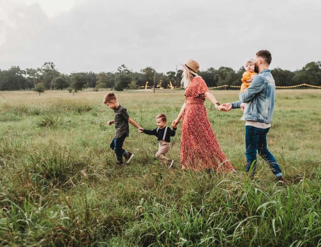 family of five holding hands in a field   10 Things To Do For The Long Weekend