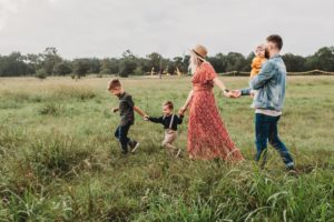 family of five holding hands in a field | 10 Things To Do For The Long Weekend