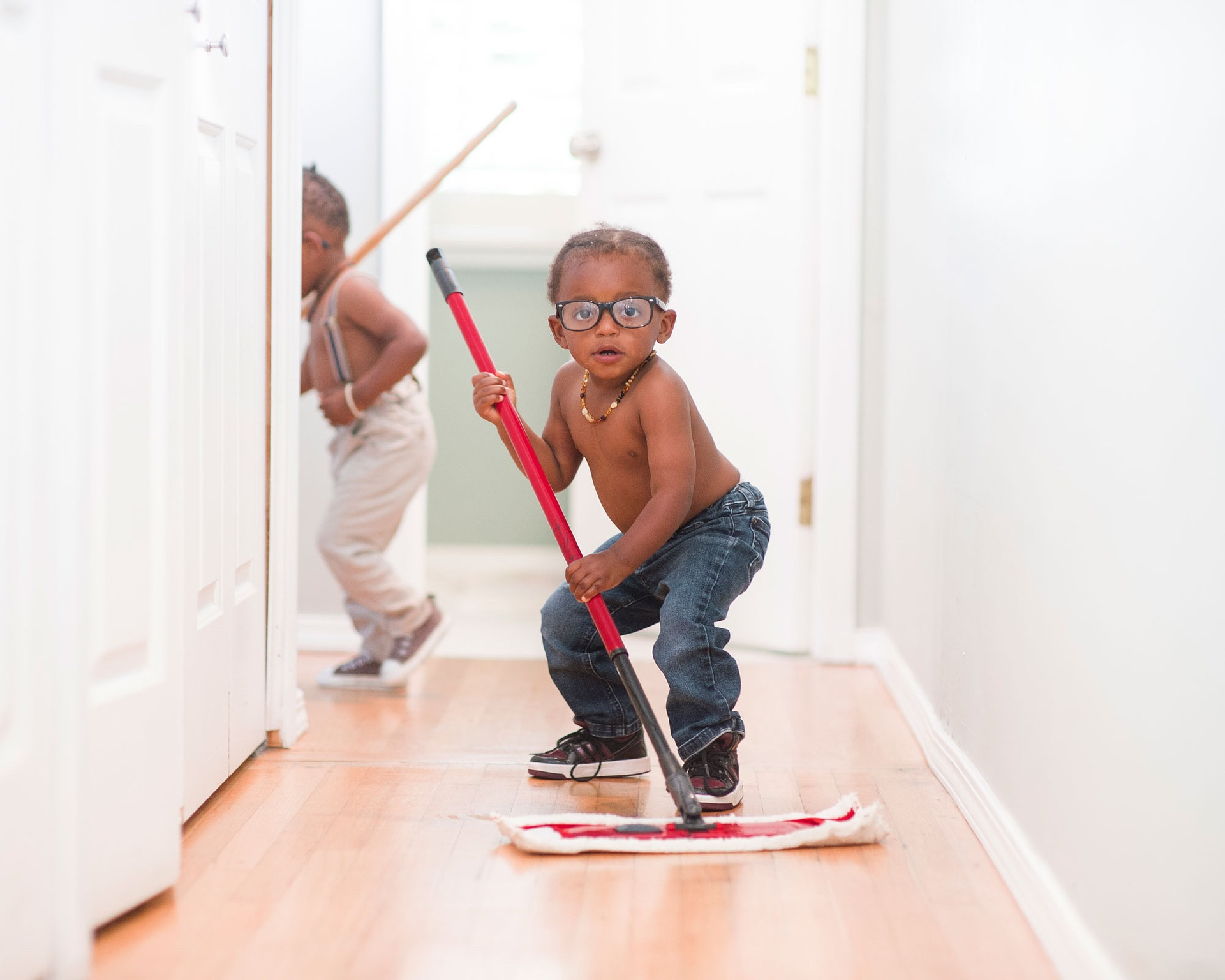 toddler holding mop