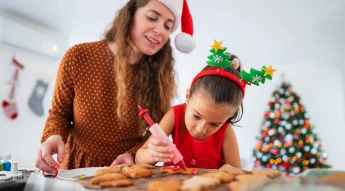 mom with daughter making cookies for christmas