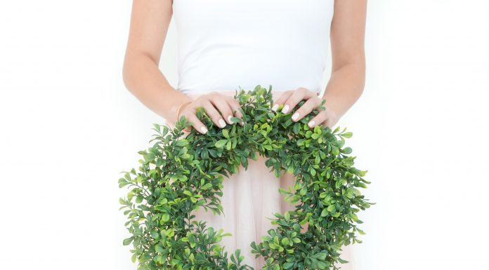 woman with a DIY holiday wreath
