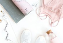 workout gear sprawled on the floor in pink