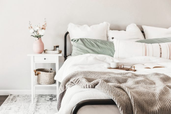comfortable bed with pillows and blankets