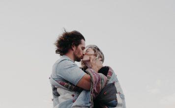 man and woman hugging and kissing