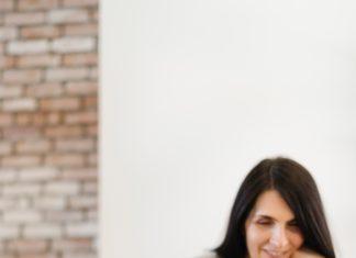 woman at computer smiling