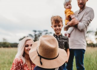 family of five in a field